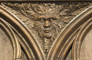 Poitiers Cathedra choir stalls carving from spandrel shoing a green man
