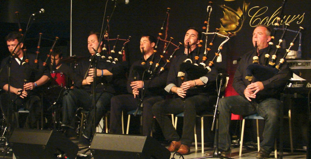 five highland bagpipe players
